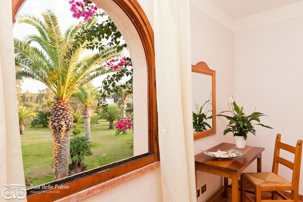 레지던스 바이아 델레 팔메(Residence Baia delle Palme) Hotel Image 13 - Guestroom