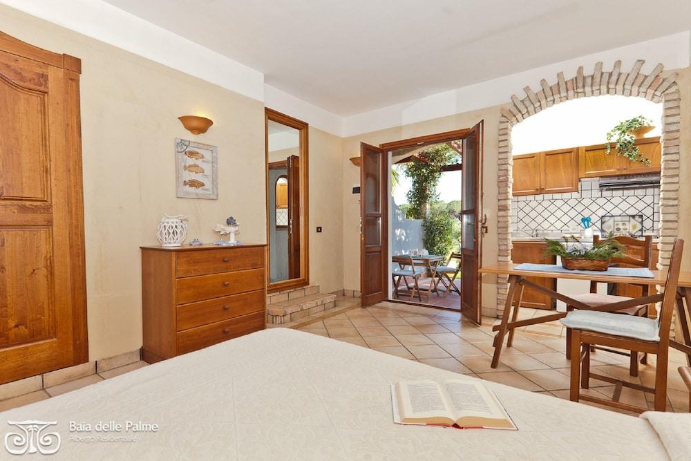 레지던스 바이아 델레 팔메(Residence Baia delle Palme) Hotel Image 5 - Guestroom
