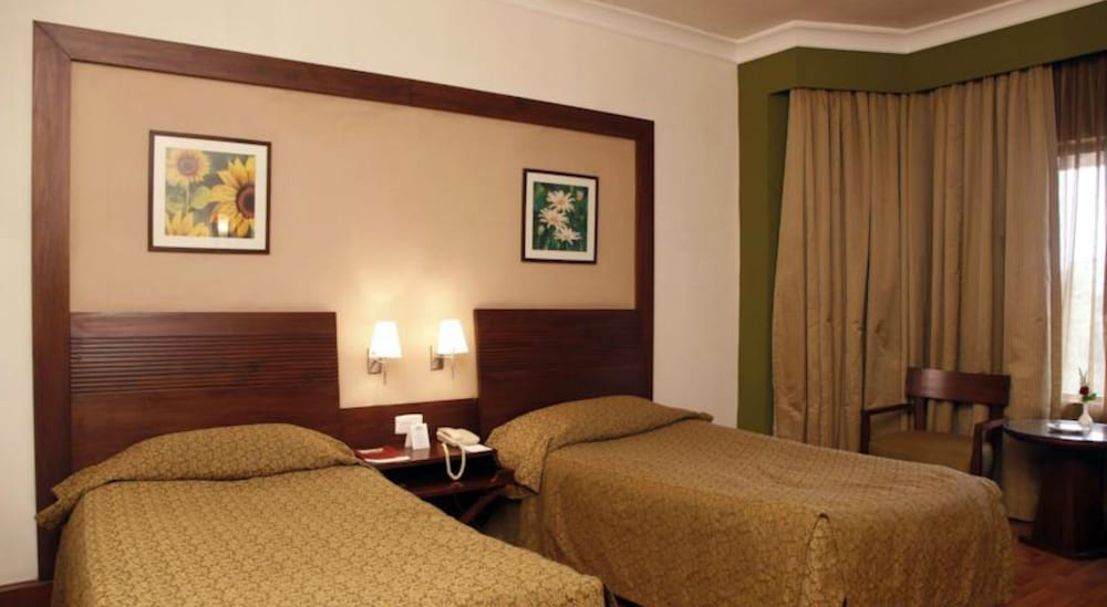 더 리트리트 호텔 & 컨벤션 센터(The Retreat Hotel & Convention Centre) Hotel Image 12 - Guestroom