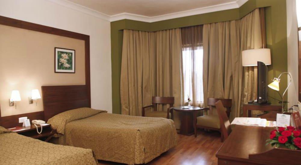 더 리트리트 호텔 & 컨벤션 센터(The Retreat Hotel & Convention Centre) Hotel Image 13 - Guestroom
