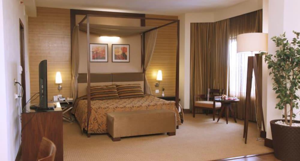 더 리트리트 호텔 & 컨벤션 센터(The Retreat Hotel & Convention Centre) Hotel Image 7 - Guestroom