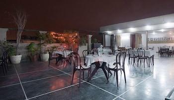 호텔 사르탁 팰리스(Hotel Sarthak Palace) Hotel Image 14 - Restaurant