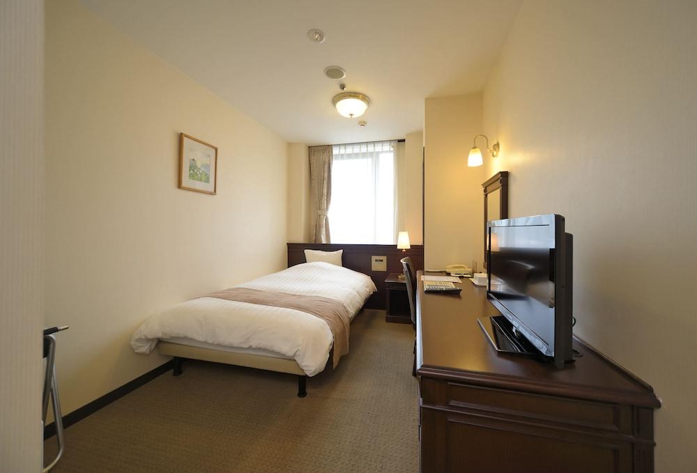 아마미 선플라자 호텔(Amami Sunplaza Hotel) Hotel Image 5 - Guestroom