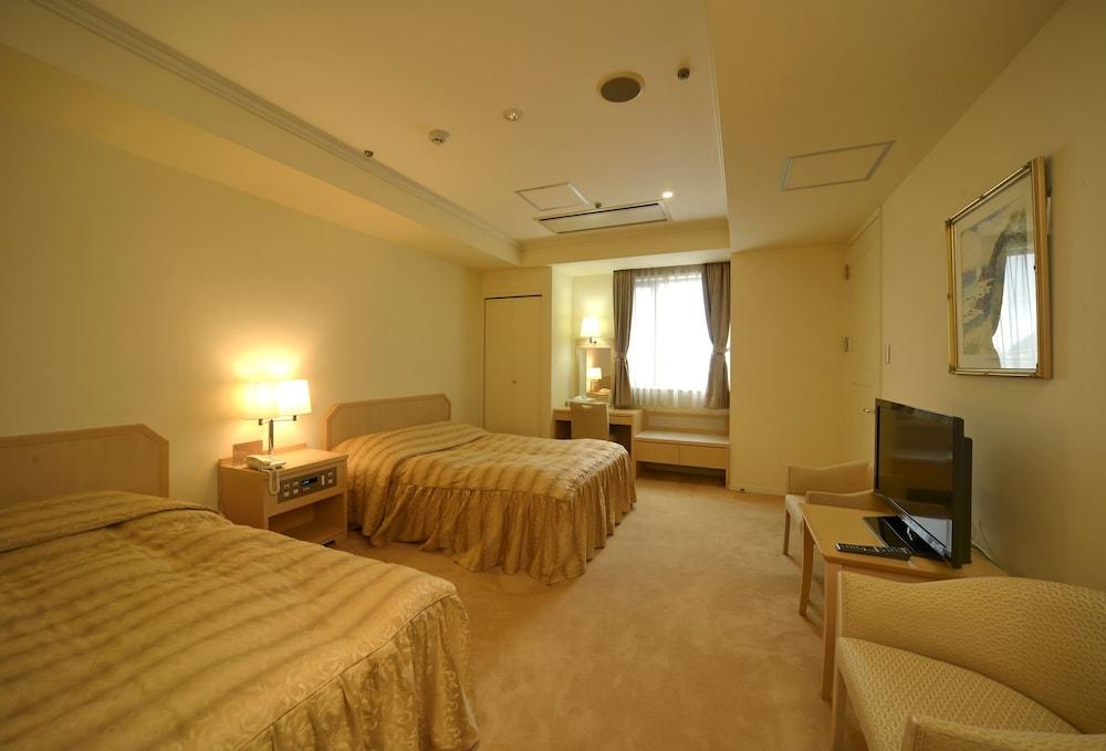 아마미 선플라자 호텔(Amami Sunplaza Hotel) Hotel Image 14 - Guestroom