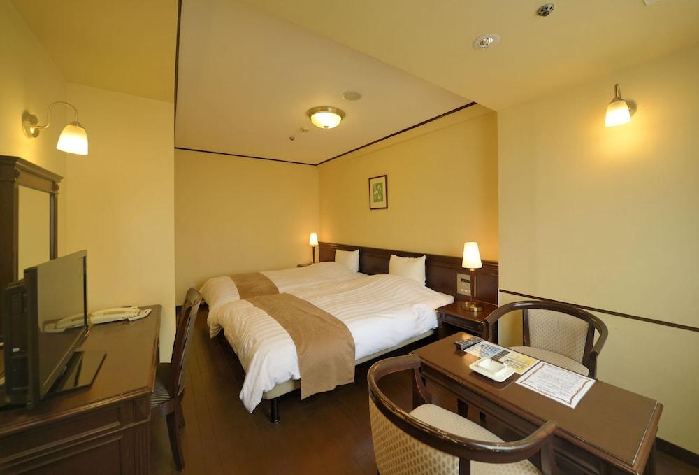 아마미 선플라자 호텔(Amami Sunplaza Hotel) Hotel Image 7 - Guestroom