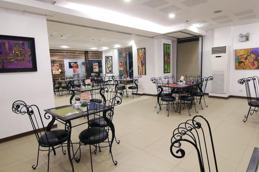 오요 103 아르티나 스위트 호텔(OYO 103 Artina Suites Hotel) Hotel Image 24 - Restaurant