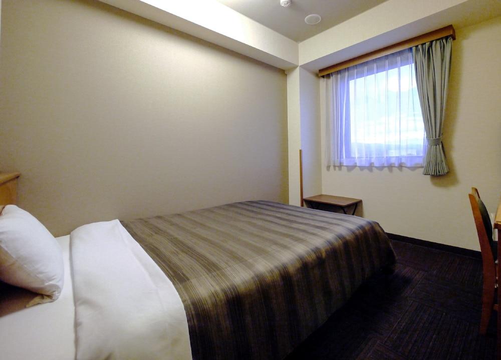 호텔 루트-인 나가이즈미 누마즈 인터 2(Hotel Route-Inn Nagaizumi Numazu Inter 2) Hotel Image 4 - Guestroom