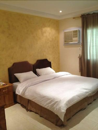 Al Alya Hotel Rooms and Suites,