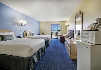 Guestroom at Coastal Palms Inn & Suites in Ocean City