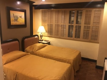 Lourdes Suites Makati Guestroom