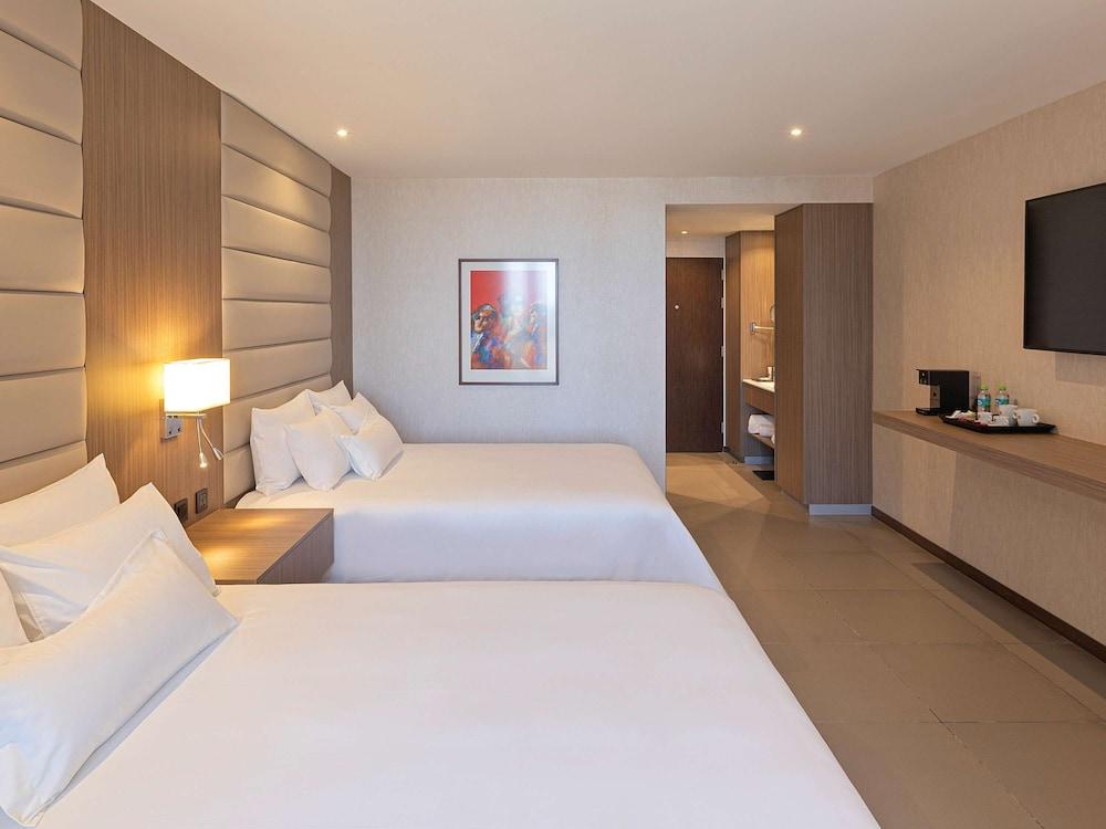 https://i.travelapi.com/hotels/61000000/60340000/60335700/60335614/8b36b9fa_z.jpg