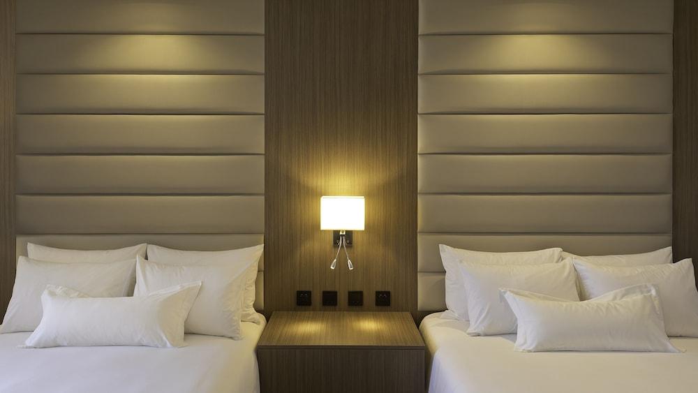 https://i.travelapi.com/hotels/61000000/60340000/60335700/60335614/bd287c64_z.jpg