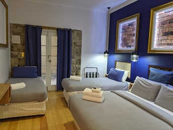 Executive Family Room - One Queen & Two Single Beds (Shared Balcony)