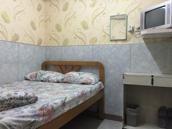 double bed with shared bathroom